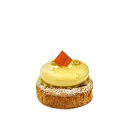 L'olive, an olive oil crémeux with lemon tapenade, green apple, turmeric, orange blossom and olive oil cake