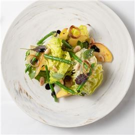 Tender lettuce leaves with green beans, sweet peaches, almonds and basil